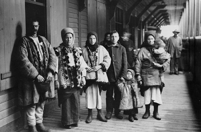 Black and white photograph of a group of immigrants in traditional dress