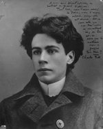 Black and white photograph of a young man with handwritten annotations in black ink in the top right corner